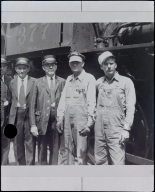 Men Standing in Front of a Locomotive