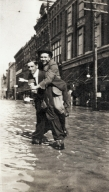 Two men on Broadway in Paducah (KY) during April 1913 flood
