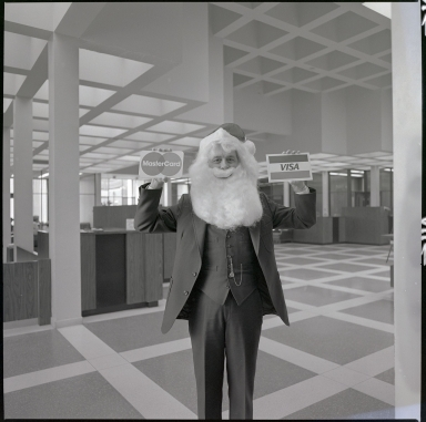 Bank Employee in Santa Beard