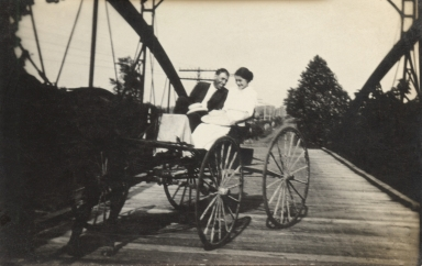 Two men in horse-drawn buggy, John Griffith on left