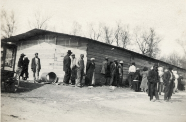 Unknown group of African Americans around building