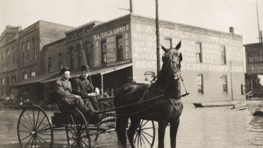 Two men in horse drawn buggy during April 1913 flood in Paducah (KY)