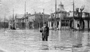 Man standing in street in Paducah (KY) during April 1913 flood