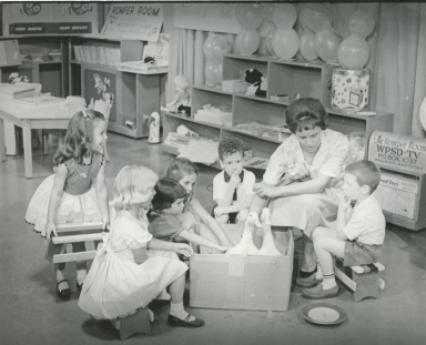Romper Room teacher and students