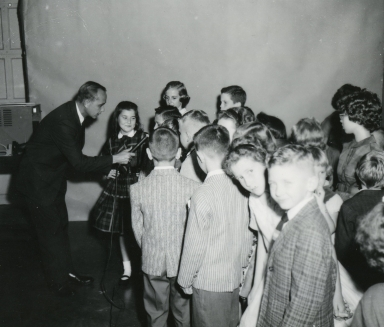 Bob Swisher interviewing children
