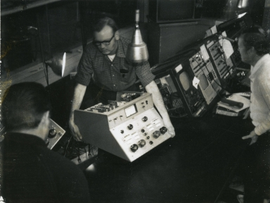 Engineers working in station control room