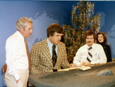 News director Tom Butler, news anchor Gary Roedemeier, sports director Frank Morock and news anchor Melinda Smith on news set