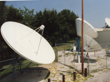 Satellite dishes behind station