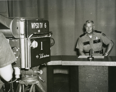 Law enforcement officer and cameraman in studio
