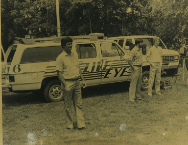 "Photographers Doug Harnice, Kenny Jones and Jim Ethridge with ""live"" trucks"