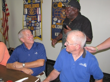 "Bob Fesmire, Sam Burrage and Ernie Mitchell at ""old employees' luncheon"""