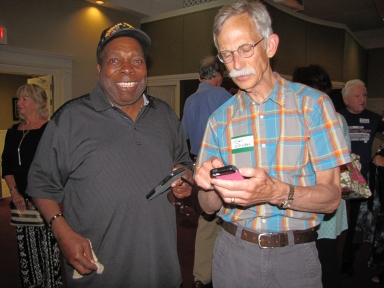 "Sam Burrage and Allan Rhodes Jr. at ""Old Timer's luncheon"""