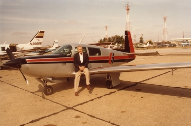 Corporate pilot Bill Watson with station plane