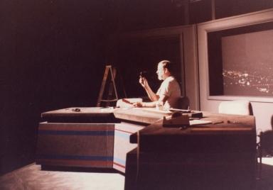 Studio supervisor Dale Watson checking light levels on news set