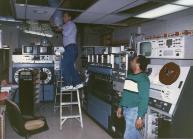 Dale Watson installing new equipment in master control, with injest operator Percy Lee