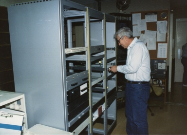 Engineer Jay Thweatt installing new equipment in master control