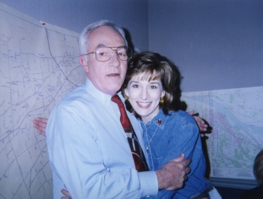News vice-president Tom Butler with co-anchor Bonnie Schrock at his retirement party