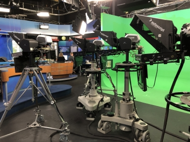 Robotic cameras in station studio