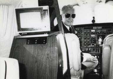 Corporate pilot Bill Watson in cockpit