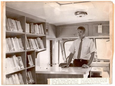 Tom Sutherland inside the Bookmobile
