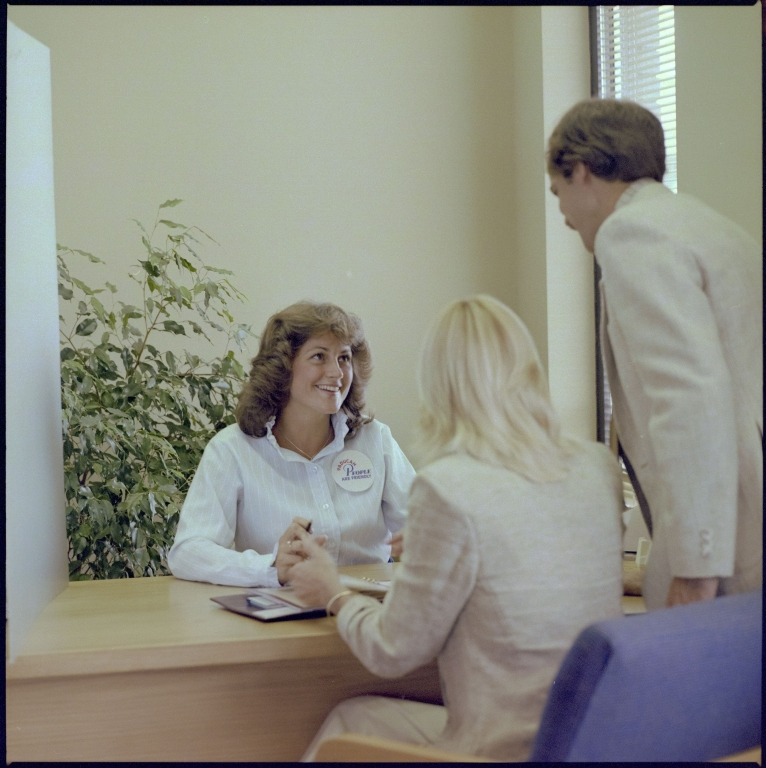 Couple Talking to a Bank Employee