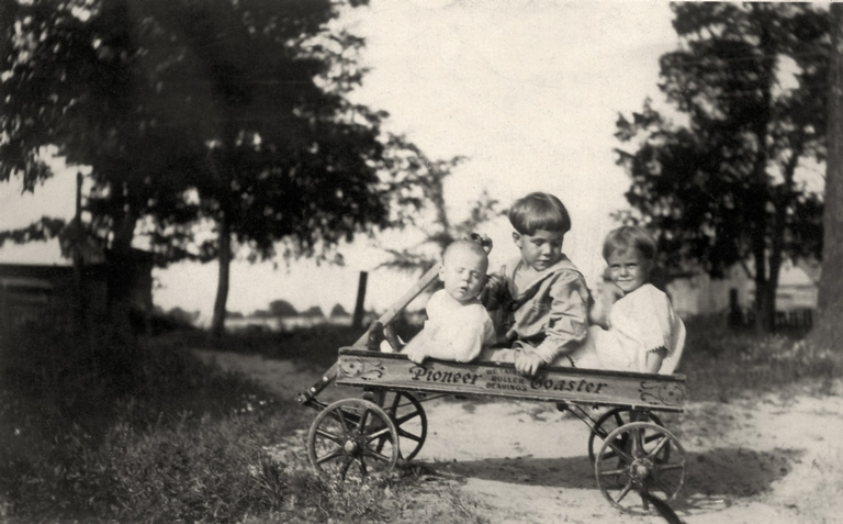 Ruth and Laura A Bell in car, Laura Ethel Bell with Richard, Laura and Robert Griffith standing