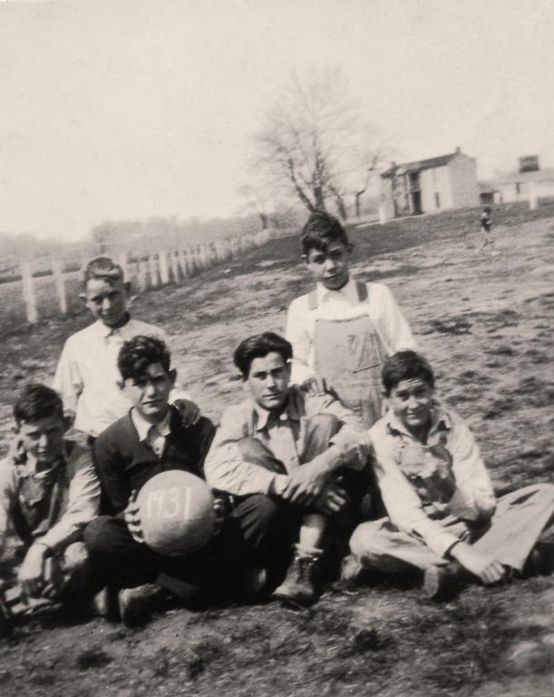 Basketball team, Robert Griffith kneeling, back row