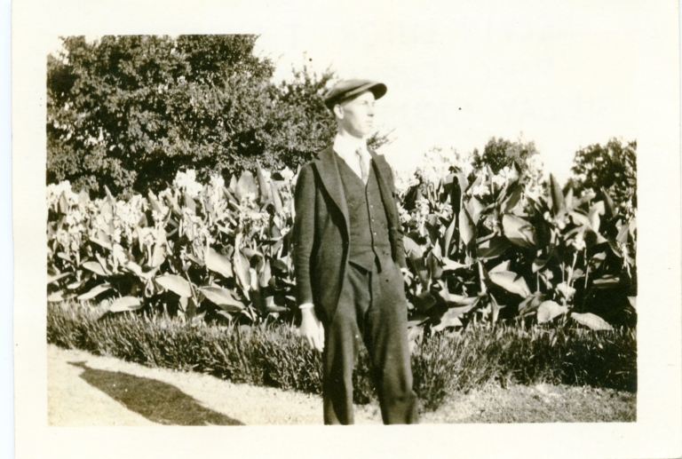 C. Melvin Luigs in front of canna lilies