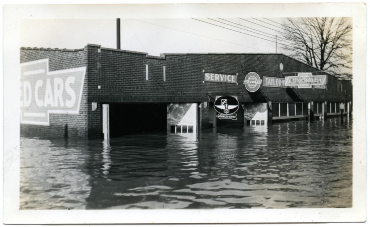 Car dealership in Paducah during '37 flood.