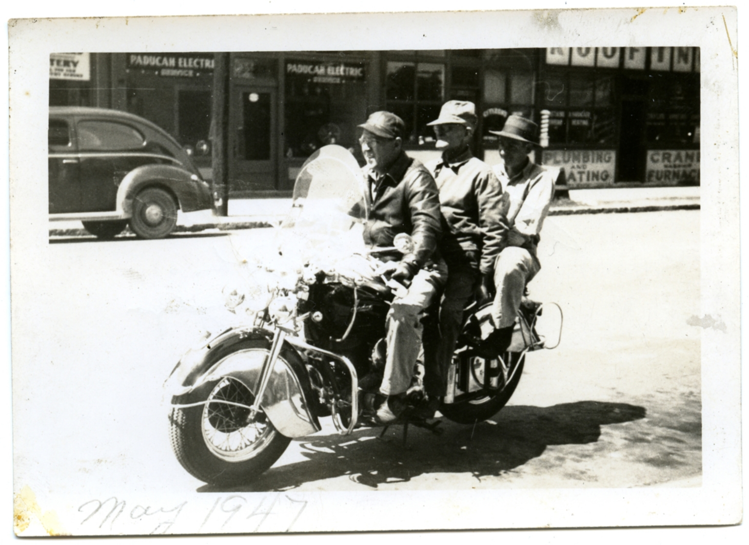 Three Men on a Motorcycle