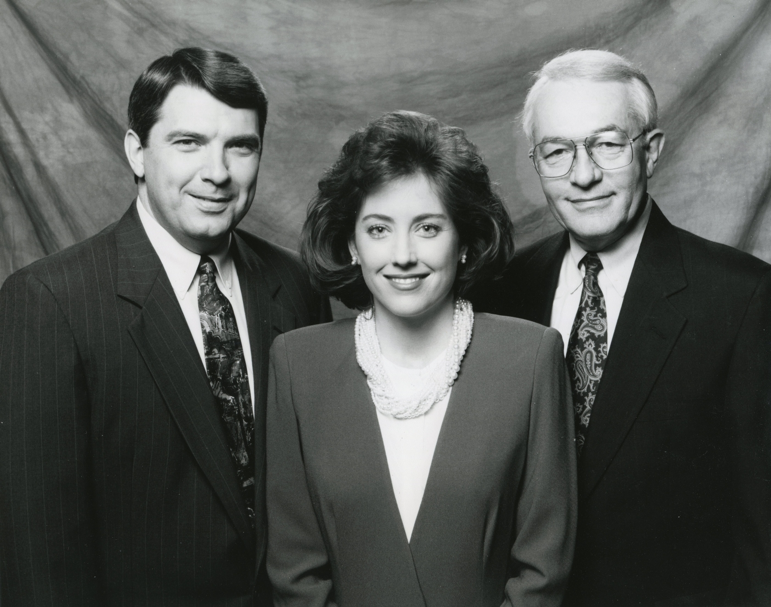 News anchor Ron Beaton, news anchor Kim Keelor, news vice-president/anchor Tom Butler