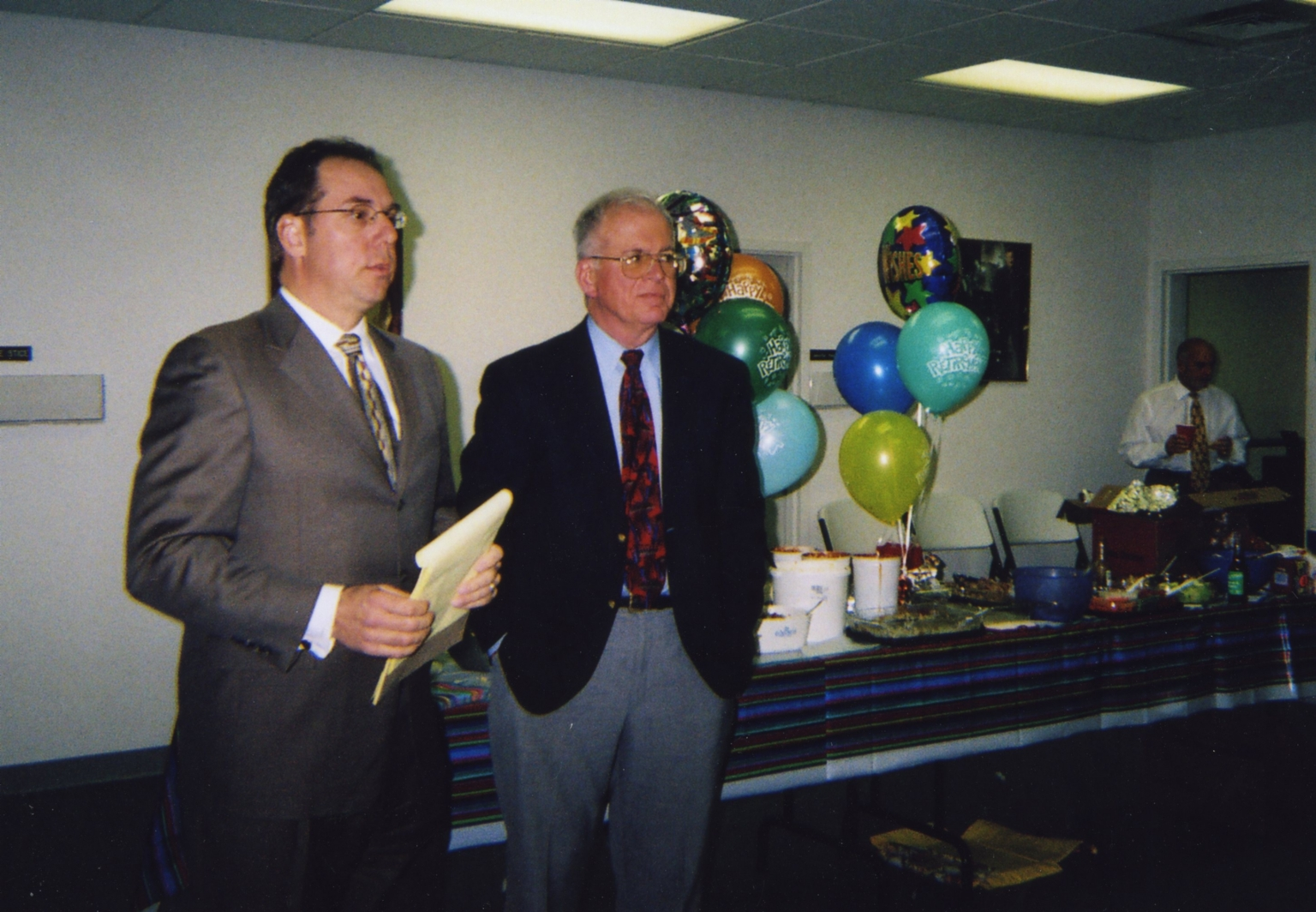 Vice-president/general manager Bill Evans and reporter/anchor Ernie Mitchell at Ernie's retirement