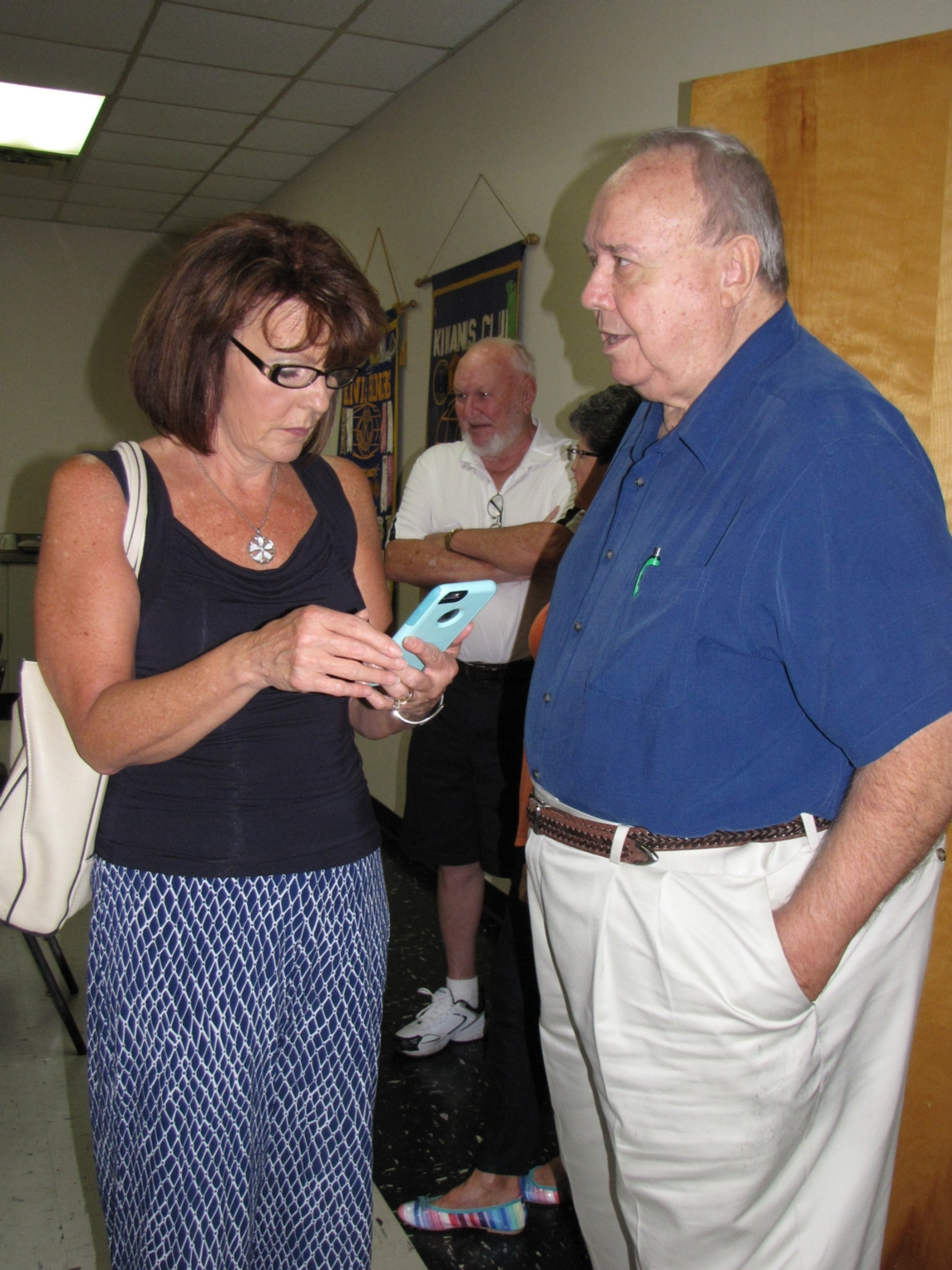 """Cindy Butterbaugh and Leo Green at """"old employees' luncheon"""""""
